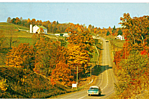 Winding Pavement through Hills...Vintage Car (Image1)