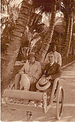 Man Woman Photo In Wicker Rolling Chair Palm Trees P30636