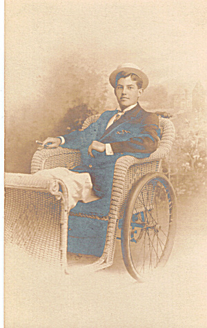 Man With Cigar In Wicker Rolling Chair Postcard P30639