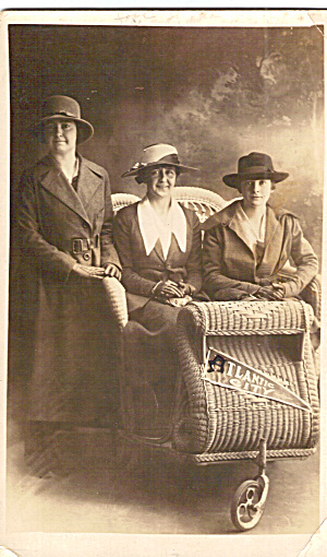 Women In Wicker Rolling Chair
