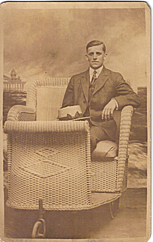 Man With Hat In Wicker Rolling Chair