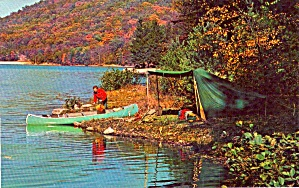 Fisher Man and His Canoe at Camp P38251 (Image1)