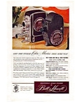 Click here to enlarge image and see more about item auc094804: Bell and Howell Movie camera Ad auc094804 Sep 1948
