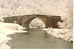 Click here to enlarge image and see more about item cs1266: Casselman River Bridge PA in Winter Postcard cs1266