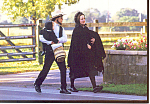 Amish Couple Walking on a Country Road Postcard