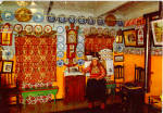 Click here to enlarge image and see more about item cs6611: Woman in Native Dress Seated in Living Room cs6611