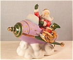 Click here to enlarge image and see more about item d1774: Lenox 2003 Santas Rocket Ride Figurine