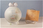 Click here to enlarge image and see more about item d2023: Precious Moments 1994 Porcelain Hanging Ornament