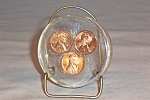 Click here to enlarge image and see more about item d2849: Lucite Paperweight 1970 Pennies