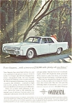 Click here to enlarge image and see more about item jan1892: 1961 Lincoln Continental 4-Door in Blue Ad