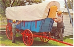Click here to enlarge image and see more about item p13393: Amish Carriagemakers Old Covered Wagon Postcard p13393