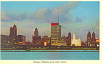 Click here to enlarge image and see more about item p13811: Chicago, IL, Skyline at night Postcard 1962