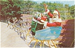 Click here to enlarge image and see more about item p1383: Wilmington  NY Santa at North Pole Postcard p1383