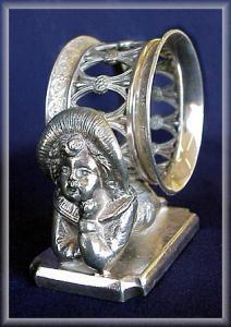 NAPKIN RING KATE GREENAWAY BOY w/ OPEN WORK RING (Image1)