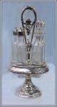 Click here to enlarge image and see more about item V7338: FIVE BOTTLE REVOLVING CASTOR SET