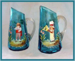 Click to view larger image of PAIR OF PITCHERS BLUE ENAMELED KATE GREENAWAY (Image1)