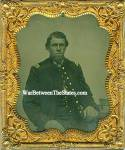 Sixth plate ambrotype of seated Union officer wearing a single breasted frock coat with shoulder straps. His coat is worn open to show his military vest. He poses next to a table with a book visible on top. Comes in a full case with brass mat, keeper and glass. Very sharp and clear image. The original photograph is much clearer than the scan indicates.