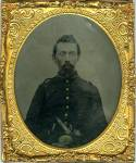 Sixth plate tintype of Union soldier sporting a goatee beard and wearing a  uniform coat with shoulder tabs, and U.S. oval belt plate (reversed in image), pistol and bowie knife can be seen sticking out of his belt. Comes in a half case, with brass mat, keeper and glass. Typical wear.