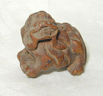 OLD NETSUKE OF A SHISHI WITH BALL