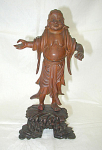 CARVED WOOD FIGURINE OF A ROBED GENTLEMAN